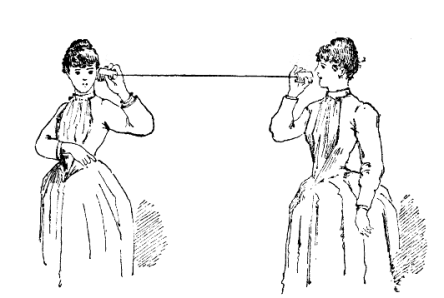 Two women in Victorian dress standing several feet apart and talking on a paper cup telephone