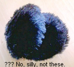 Black furry ear muffs with caption - No, silly, not these.
