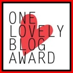 One Lovely Blog Award logo red heart behind words One Lovely Blog Award