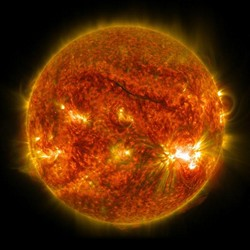 The sun, with hot spots and solar flares bubling up from the surface
