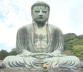 An ancient statue of the buddha with a serene facial expression