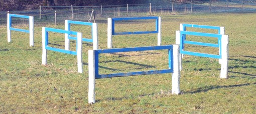 A course of horse hurdles in a field