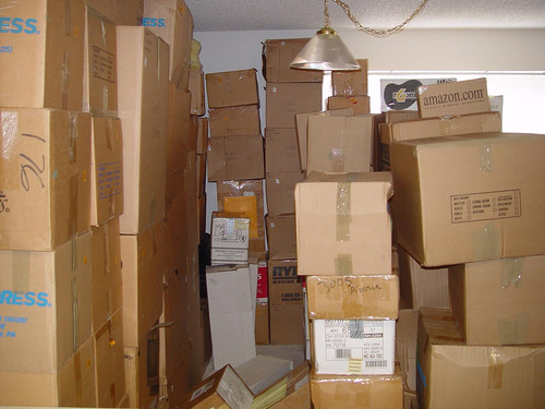 Stacked moving boxes filling most of a room
