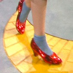 Closeup of Dorothy's ruby slippers as she starts on the yellow brick road in The Wizard of Oz