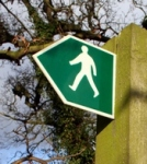 Sign with a silhouette of a person walking
