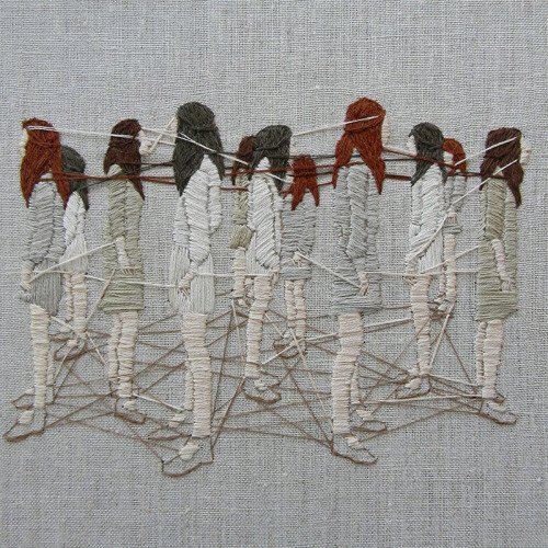 An embroidered picture of several women facing away from each other, but with threads connecting them at the feet, hands and heads.