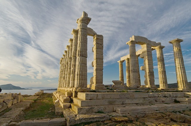 The ruins of a Greek temple, crumbling pilars wiht no roof