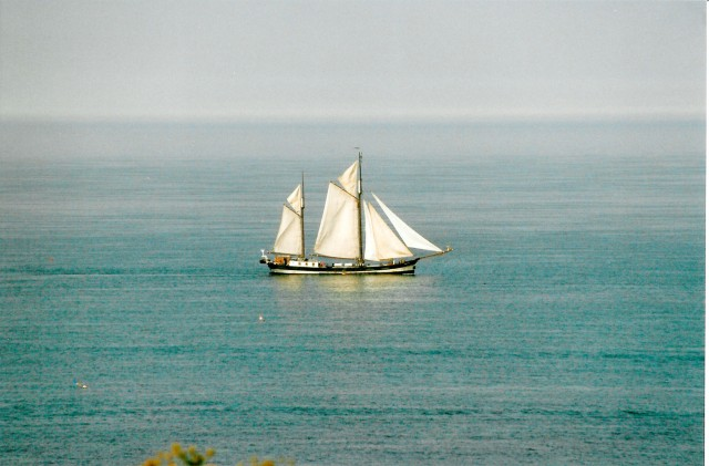 An old time sailing ship on a calm sea