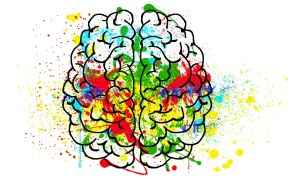 Line drawing of brain splashed with brilliant colors