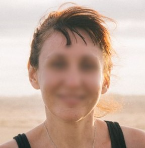 Smiling face of a woman with features blurred